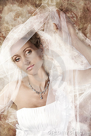Bride in white veil at vintage background.