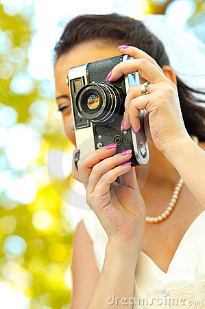 Free Bride With Old Retro Camera Taking Pictures Royalty Free Stock Photography - 21052287