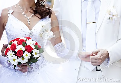 Bridegroom keeping bride hand