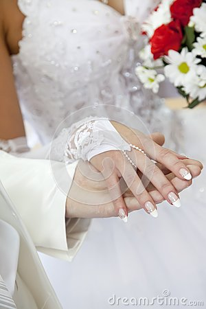 Bridegroom keeping bride hand
