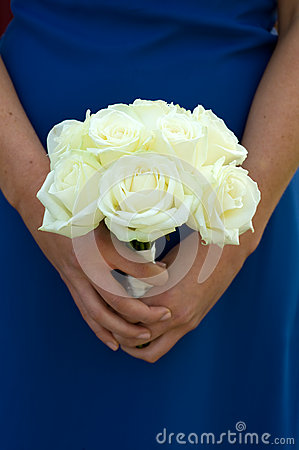 Bridesmaid holding white rose wedding bouquet