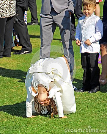 Free Bridesmaid Performing Acrobatic Stunts At Wedding Reception Stock Image - 152940381