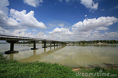 Bridge across river against blue sky and cloud