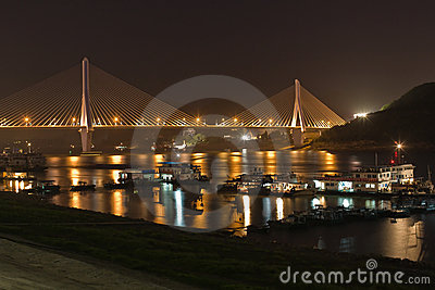 Bridge and boats at night