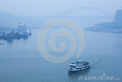 Bridge crossing the river, heavy fog and haze