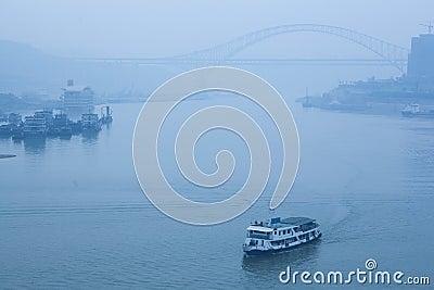 Bridge crossing the river, heavy fog and haze