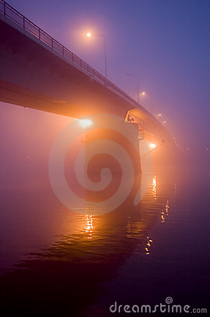 Bridge in the fog by night