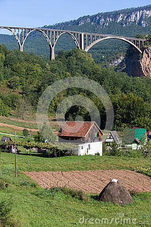 Free Bridge Is A Concrete Arch Bridge Over The Tara River In Northern Montenegro Royalty Free Stock Images - 60283489
