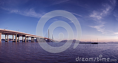 Bridge and lakes in blue sky