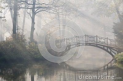 Bridge in misty morning