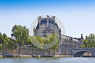 Bridge Pont du Carrousel and famous museum Louvre
