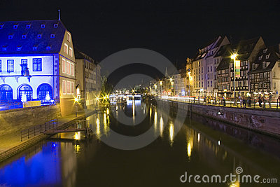 Bridge and quay in old town strasbourg by night