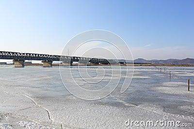 Bridge through  river covered  ice