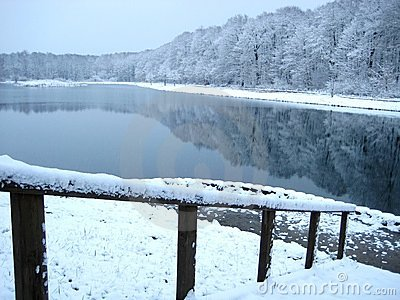 The bridge on snow-covered lake