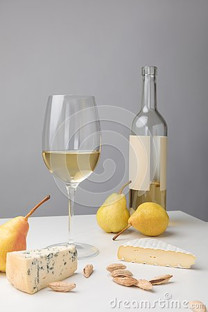 Free Brie And Dorblu Cheese With Pears, Almond, Wine Glass And Bottle On Gray Stock Photo - 127716980