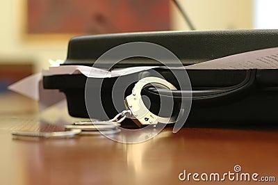 Briefcase and handcuffs