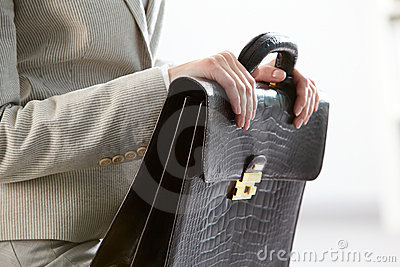 Briefcase in hands