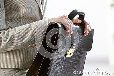 Briefcase in hands