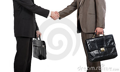 Briefcases and shaking hands