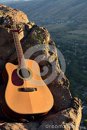 Free Bright Acoustic Guitar In The Mountains Stock Photo - 60696750