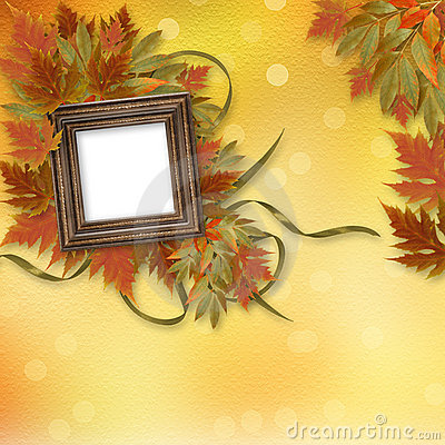 Bright autumn leaves with wooden fram