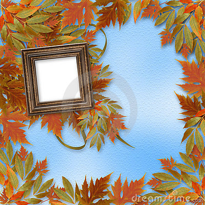 Bright autumn leaves with wooden frame