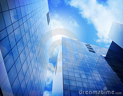 Bright Blue City Buildings with Clouds