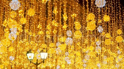 Bright Christmas Street Illumination. The City is Decorated for the Christmastide Holiday. New Year Lights Decorating. Shimmering bokeh. Burning lanterns on stock footage