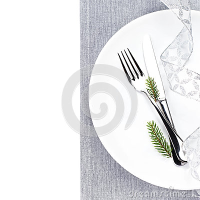 Bright Christmas table setting place with festive decorations on