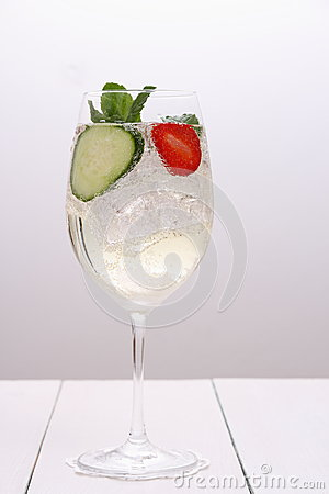 Free Bright Cocktail With Cucumber, Strawberry In Wine Glass Royalty Free Stock Photo - 41881005