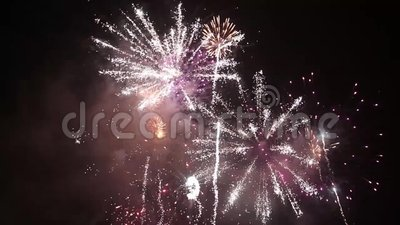 Bright colorful fireworks on new years eve in Ostrava, Czech republic against cloudy sky, no audio.  stock footage
