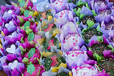 Bright colourful cupcakes in rows