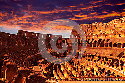 Bright crimson sunset over the ancient Colosseum during a sunset. Rome. Italy