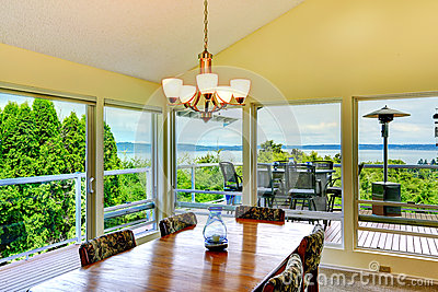 Bright dining room with glass walls