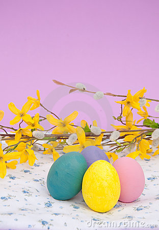 Bright Easter eggs on a floral patterned cloth