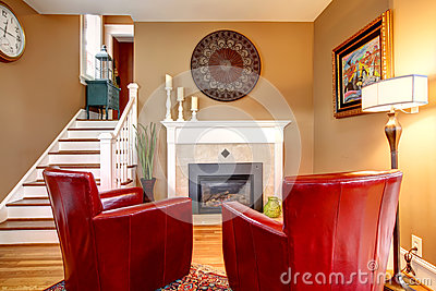 Bright family room with electric fireplace and elegant red chair
