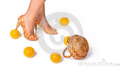 Bright high heeled shoes and oranges