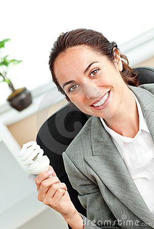 Bright hispanic businesswoman holding a light bulb