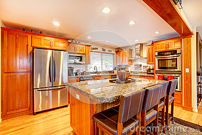Cabinets steel appliances view of island with marble counter top and