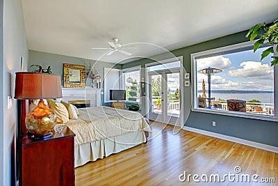 Bright large luxury blue bedroom interior.