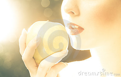 Bright picture of woman s lips with an apple