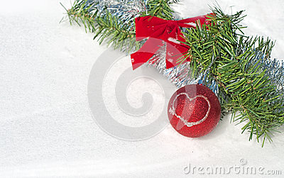 Bright red Christmas ball ornament in snow