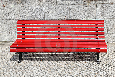 Bright red park bench