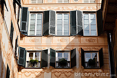 Bright Sunlit Painted House Facade in Genoa