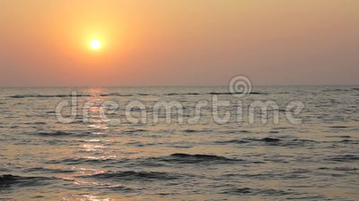 Bright sunset sky with a sun path to the sea on the background of the ocean. A bright sunset sky with a sun path to the sea on the background of the ocean stock video