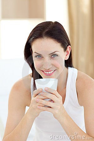 Bright woman drinking a coffee