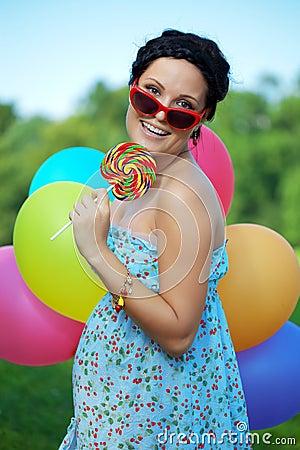 Bright woman in sunglasses