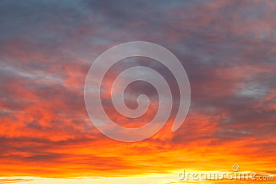 Bright yellow clouds under blue sky in sunrise