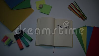 Brightening up word Idea written on note pad stock video footage
