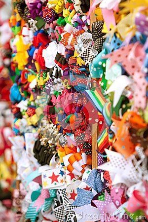 Brightly Colored Hat Ribbons Fill Wall